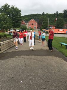 Seniors demonstrating Tai Chi
